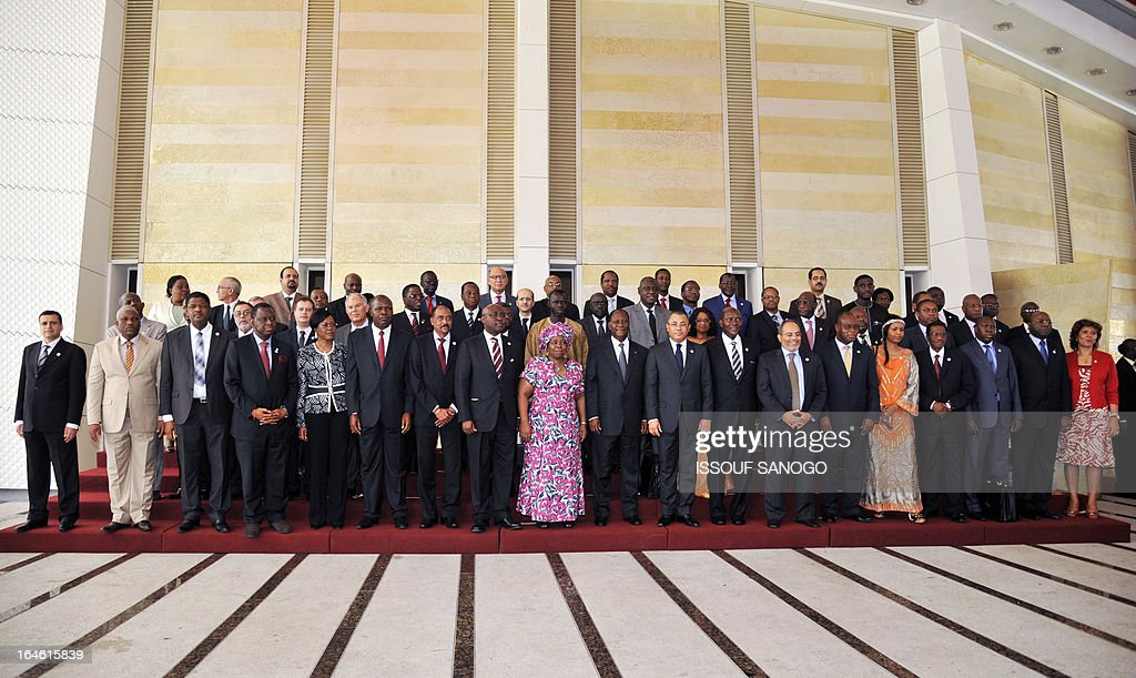 Ivory Coast's President Alassane Ouattara (C, L) and African Commision President Nkosazana Dlamini-Zuma (C, L) pose on March 25, 2013 for the family photo during the opening of the sixth meeting of the finance and economy ministers and the African Union Development Planning in Abidjan.