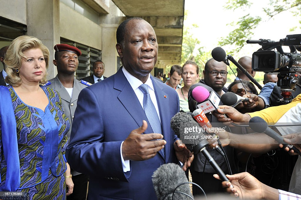 Ivory Coast's president Alassane Ouattara and first lady Dominique (L) speaks to media after voting on April 21, 2013 at the Lycee Sanite-Marie polling station in Abidjan. Ivorians voted Sunday in local elections seen as a trial run for a presidential poll in 2015 amid high tensions as the party of former president Laurent Gbagbo boycotted the poll.