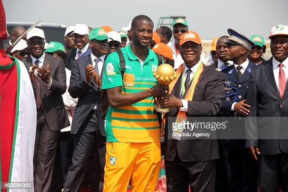 Ivory Coast's President Alassane Ouattara and Ivory Coast's national football team captain Yaya Toure pose with the African Cup of Nations trophy...