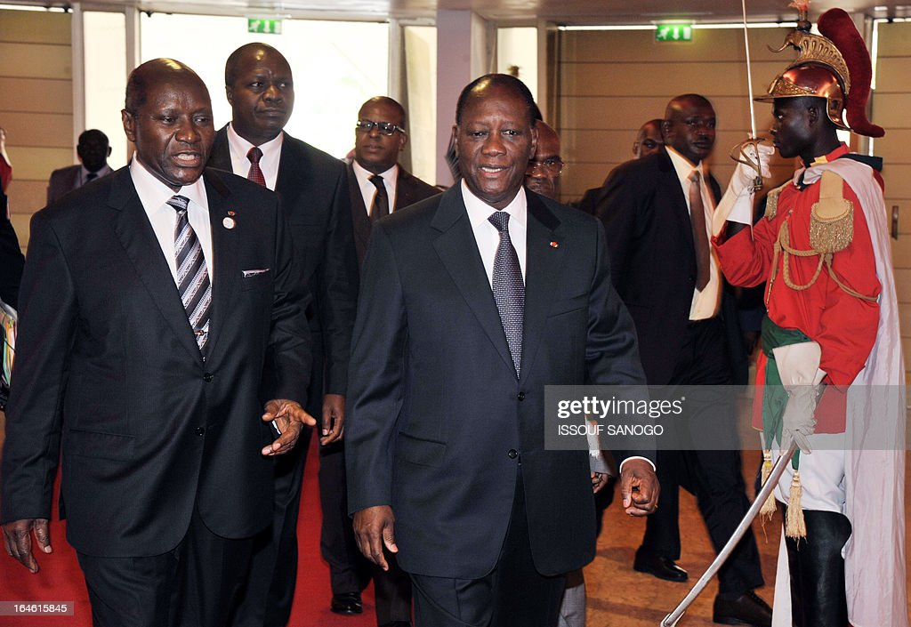 Ivory Coast's President Alassane Ouattara (C) and Prime Minister Daniel Kablan Duncan (L) arrive on March 25, 2013 to attend the opening of the sixth meeting of the finance and economy ministers and the African Union Development Planning in Abidjan.