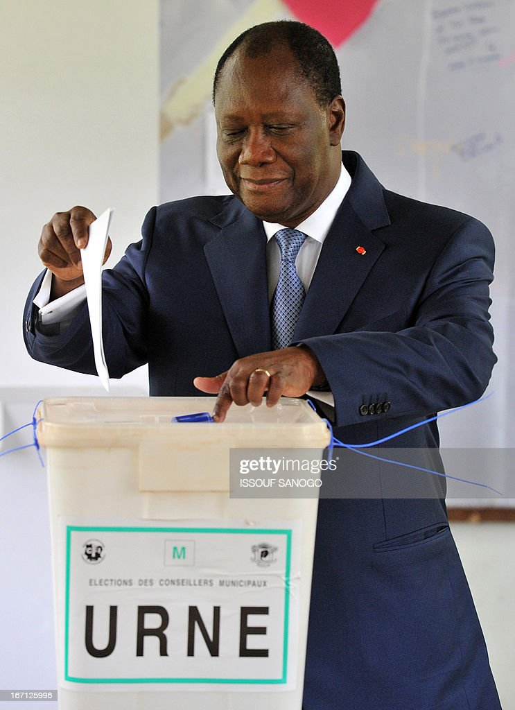 Ivory Coast's president Alassane Ouattara casts his vote at a polling station of the Lycee Sainte-Marie in Abidjan on April 21, 2013 . Ivorians voted Sunday in local elections seen as a trial run for a presidential poll in 2015 amid high tensions as the party of former president Laurent Gbagbo boycotted the poll.