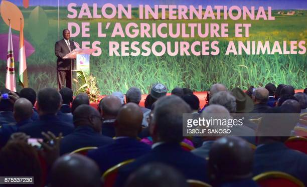 Ivory Coast's President Alassane Ouattara delivers a speech during the opening of the 4th edition of the International Exhibition of Agriculture and...