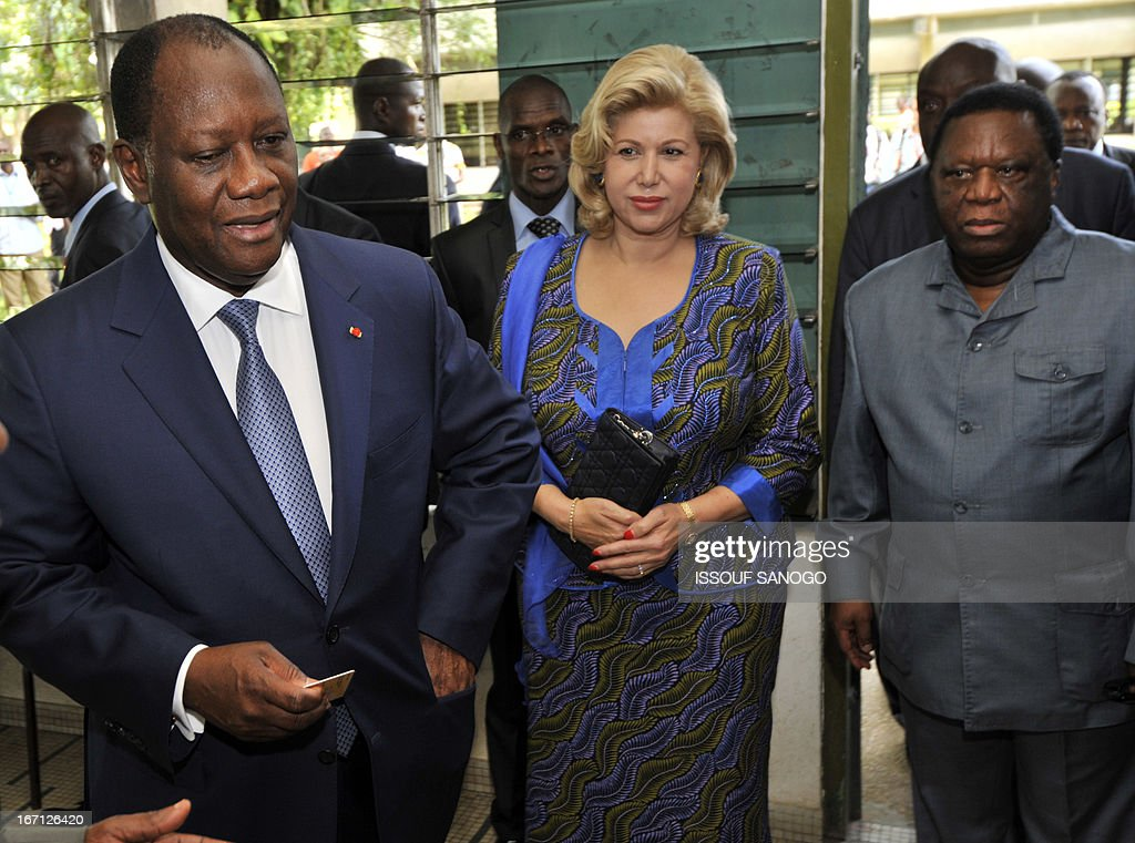 Ivory Coast's president Alassane Ouattara, first lady Dominique and Youssouf Bakayoko, the president of Ivory Coast's Electoral Commission, arrive on April 21, 2013 at the Lycee Sainte-Marie polling station in Abidjan. Ivorians voted Sunday in local elections seen as a trial run for a presidential poll in 2015 amid high tensions as the party of former president Laurent Gbagbo boycotted the poll.