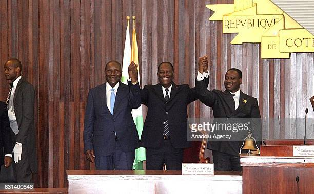 Ivory Coast's President Alassane Ouattara Former Prime Minister Daniel Kablan Duncan and Parliament Speaker Soro Guillaume greet the lawmakers after...