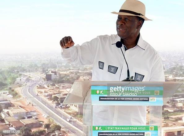 Ivory Coast's President Alassane Ouattara gestures as he delivers a speech during the inauguration of the Mohammed VI Expressway a 46 km expressway...