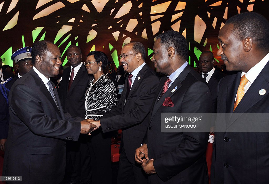 Ivory Coast's President Alassane Ouattara (L) greets participants on March 25, 2013 during the opening of the sixth meeting of the finance and economy ministers and the African Union Development Planning in Abidjan.