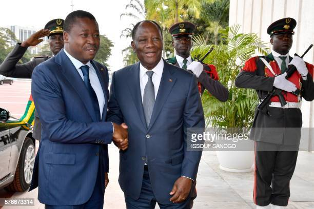 Ivory Coast's President Alassane Ouattara shakes hands with Togo's President Faure Gnassingbe as he welcomes him at the presidential palace in...