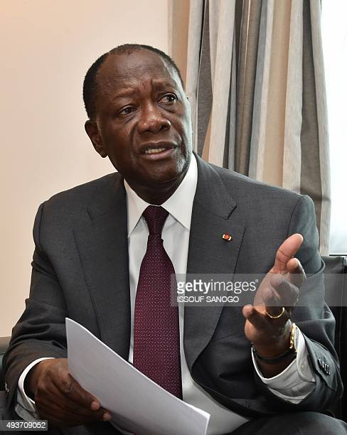 Ivory Coast's president Alassane Ouattara smiles during an interview on October 22 2015 in Abidjan ahead of presidential elections Five years after...