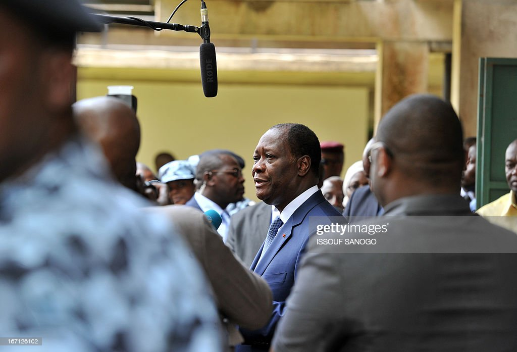 Ivory Coast's president Alassane Ouattara (C) speaks to the media after voting at a polling station of the Lycee Sainte-Marie in Abidjan on April 21, 2013 . Ivorians voted Sunday in local elections seen as a trial run for a presidential poll in 2015 amid high tensions as the party of former president Laurent Gbagbo boycotted the poll.