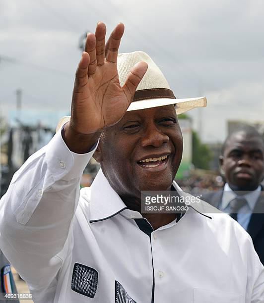 Ivory Coast's President Alassane Ouattara waves to the crowd during the inauguration of the Mohammed VI Expressway a 46 km expressway named after...