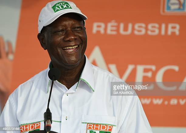 Ivory Coast's President and candidate for the upcoming election Alassane Ouattara delivers a speech during a campaign rally in the Attecoube district...