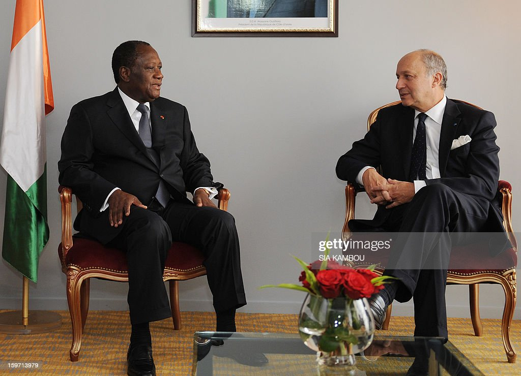 Ivory Coast's President and ECOWAS chairman Alassane Ouattara (L) speaks with French Foreign Minister Laurent Fabius (R) on January 19, 2013 in Abidjan, prior to an emergency summit of west African bloc (ECOWAS) to discuss the foreign intervention in Mali. The summit takes place with ECOWAS countries promising to send more than 3,000 soldiers to join French forces backing the Malian army against Islamist rebels.
