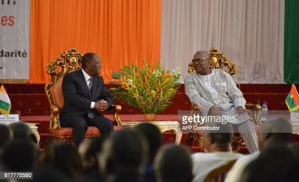Ivory Coast's Presidents Alassane Ouattara and Burkina Faso President Roch Marc Christian Kabore speak during a summit of the Treaty of Friendship...