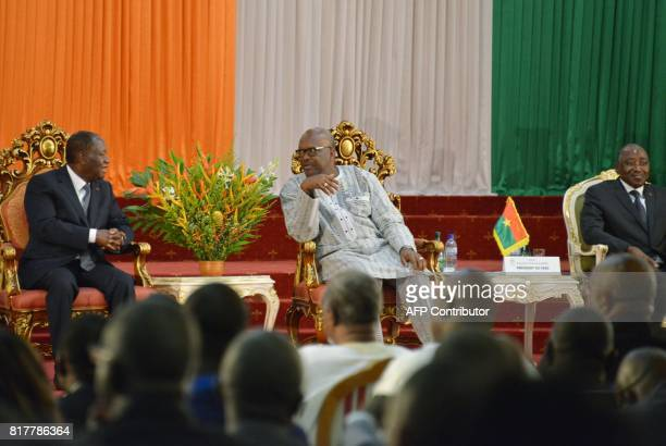 Ivory Coast's Presidents Alassane Ouattara Burkina Faso President Roch Marc Christian Kabore and and Ivory Coast's Prime Minister Amadou Gon...