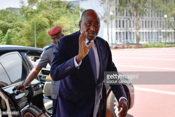 Ivory Coast's Primer Minister Amadou Gon Coulibaly waves as he arrives at the presidential palace on October 2 in Abidjan / AFP PHOTO / ISSOUF SANOGO