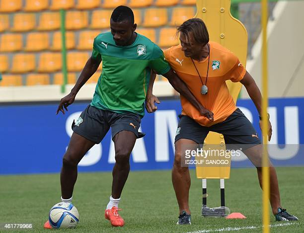 Ivory Coast's Salomon Kalou practices with his coach Herve Renard during a training session at Malabo stadium on the eve of the team's first match as...