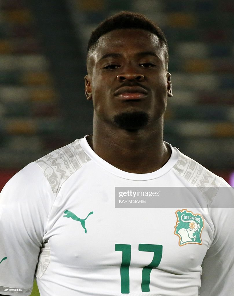 Ivory Coast's <a gi-track='captionPersonalityLinkClicked' href=/galleries/search?phrase=Serge+Aurier&family=editorial&specificpeople=6716046 ng-click='$event.stopPropagation()'>Serge Aurier</a> stands on the pitch before the preparatory friendly football match Sweden versus Ivory Coast ahead of the African Cup of Nations on January 15, 2015 in Abu Dhabi.