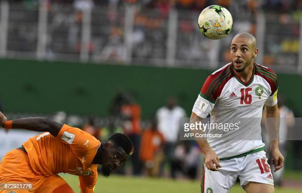 Ivory Coast's Serge Aurier vies with Morocco's Noureddine Amrabat during the FIFA World Cup 2018 Africa Group C qualifying football match between...