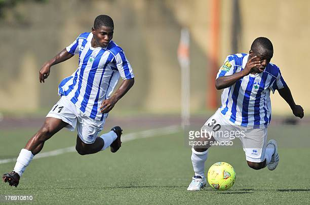 Ivory Coast's Sewe Sport de San Pedro players Roger Claver and Ocansey Mandela run after the ball during the African Champions league football match...