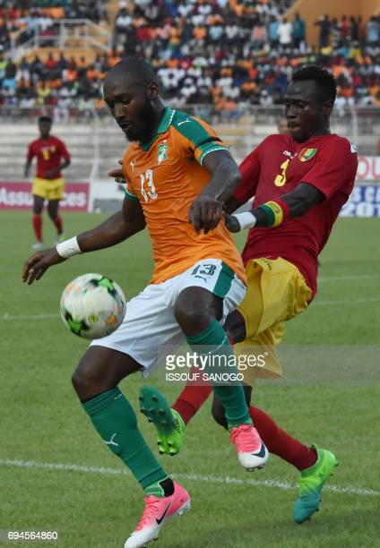 Ivory Coast's Sio Giovanni vies with Guinea's Issiaga Sylla during the 2019 African Cup of Nations qualifyer football match between Ivory Coast and...