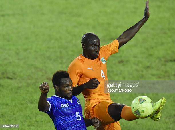 Ivory Coast's Souleyman Bamba vies for the ball with Sierra Leone's Julius Woban during the 2015 African Cup of Nations qualifying football match...
