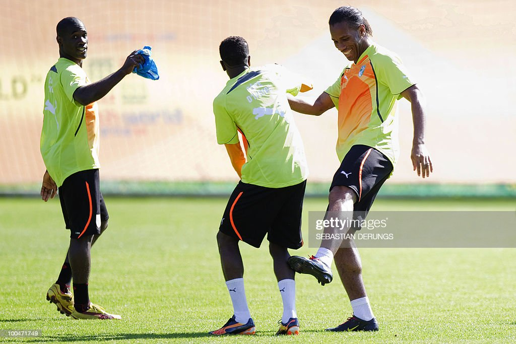Ivory Coast's striker Didier Drogba (R) jokes with unidentified teammates during a practice session on May 24, 2010 in Saanen, Switzerland, ahead of the FIFA World Cup 2010 finals in South Africa.