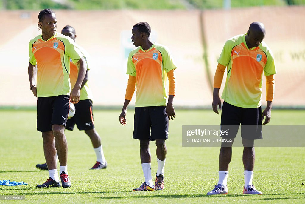 Ivory Coast's striker Didier Drogba (L) looks at his teammates during a practice session on May 24, 2010 in Saanen, Switzerland, ahead of the FIFA World Cup 2010 finals in South Africa.