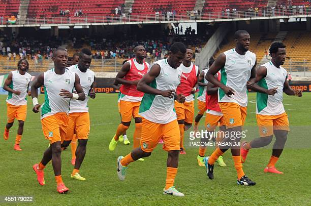 Ivory Coast's team players take part in a training session prior to the 2015 African Cup of Nations qualifying football match between Cameroon and...