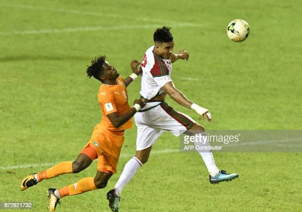 Ivory Coast's Wilfried Zaha vies with Morocco's Nabil Dirar during the FIFA World Cup 2018 Africa Group C qualifying football match between Ivory...