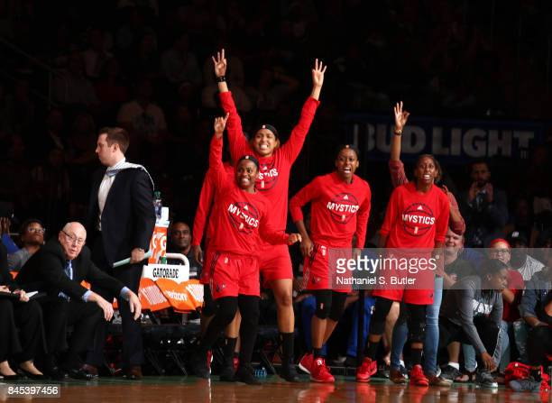Ivory Latta and Tianna Hawkins of the Washington Mystics with teammates react during the game against the New York Liberty in Round Two of the 2017...