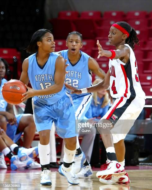 Ivory Latta looks for someone to pass to as Anesia Smith guards during a game at Comcast Center in College Park MAryland on January 9 2005
