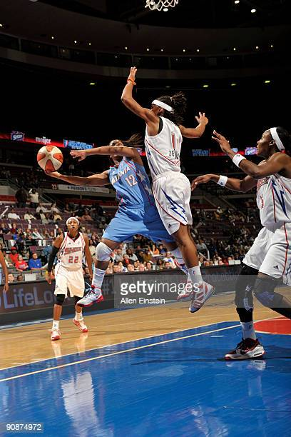 Ivory Latta of the Atlanta Dream attempts a shot against Shavonte Zellous of the Detroit Shock in Game One of the WNBA Eastern Conference SemiFinals...
