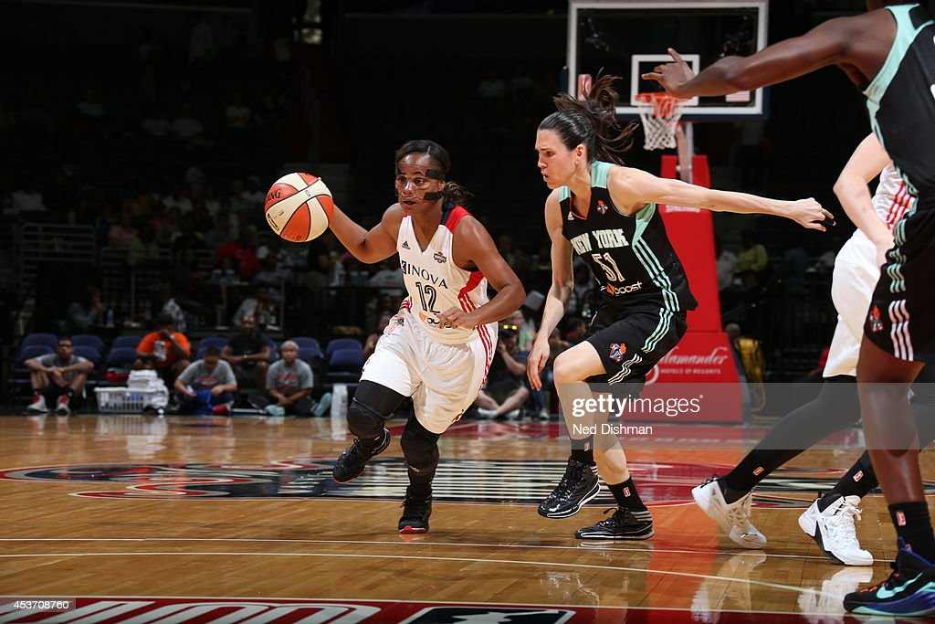 <a gi-track='captionPersonalityLinkClicked' href=/galleries/search?phrase=Ivory+Latta&family=editorial&specificpeople=707962 ng-click='$event.stopPropagation()'>Ivory Latta</a> #12 of the Washington Mystics drives against Anna Cruz #51 of the New York Liberty at the Verizon Center on August 16, 2014 in Washington, DC.