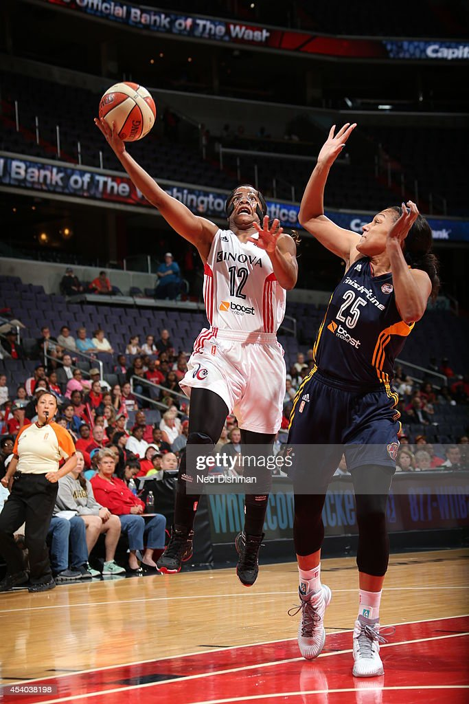 Ivory Latta #12 of the Washington Mystics drives to the basket against Marissa Coleman #25 of the Indiana Fever in Game Two of the Eastern Conference Semifinals during the 2014 WNBA Playoffs on August 23, 2014 at the Verizon Center in Washington, DC.