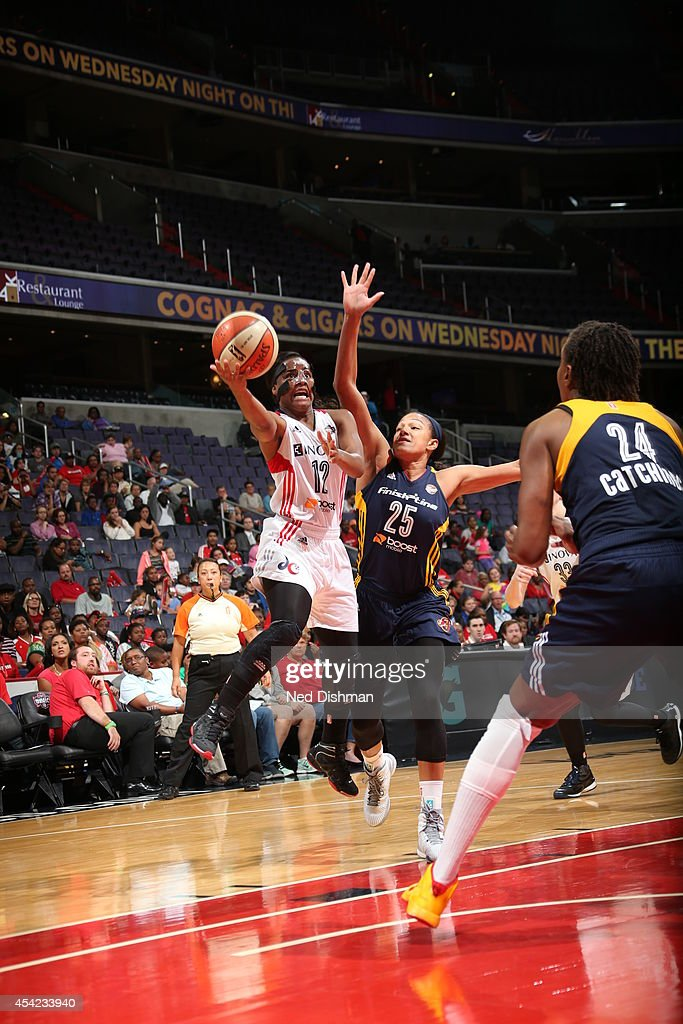 <a gi-track='captionPersonalityLinkClicked' href=/galleries/search?phrase=Ivory+Latta&family=editorial&specificpeople=707962 ng-click='$event.stopPropagation()'>Ivory Latta</a> #12 of the Washington Mystics drives to the basket against Marissa Coleman #25 of the Indiana Fever in Game Two of the Eastern Conference Semifinals during the 2014 WNBA Playoffs on August 23, 2014 at the Verizon Center in Washington, DC.