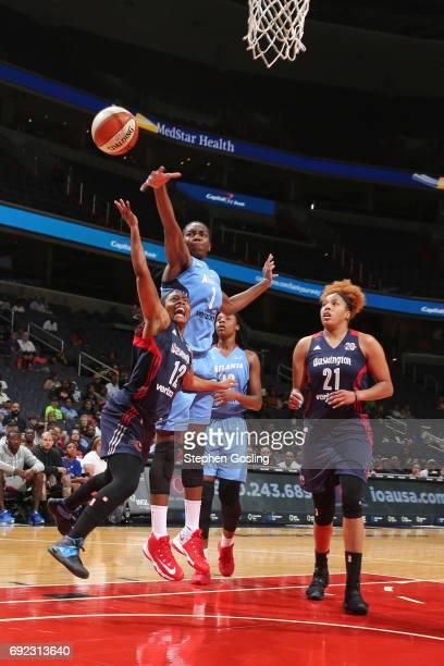 Ivory Latta of the Washington Mystics drives to the basket against Elizabeth Williams of the Atlanta Dream on June 4 2017 at Verizon Center in...