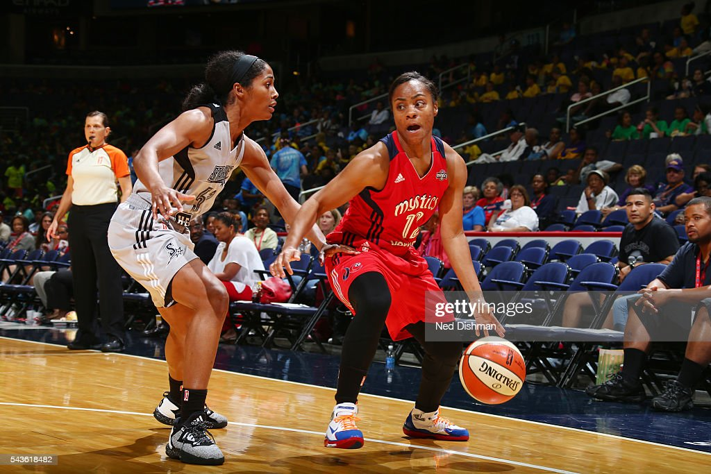 <a gi-track='captionPersonalityLinkClicked' href=/galleries/search?phrase=Ivory+Latta&family=editorial&specificpeople=707962 ng-click='$event.stopPropagation()'>Ivory Latta</a> #12 of the Washington Mystics handles the ball against Sydney Colson #51 of the San Antonio Stars on June 29, 2016 at the Verizon Center in Washington, DC.