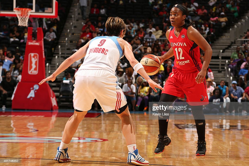 Ivory Latta #12 of the Washington Mystics handles the ball against the Atlanta Dream at Philips Arena on July 5, 2014 in Atlanta, Georgia.