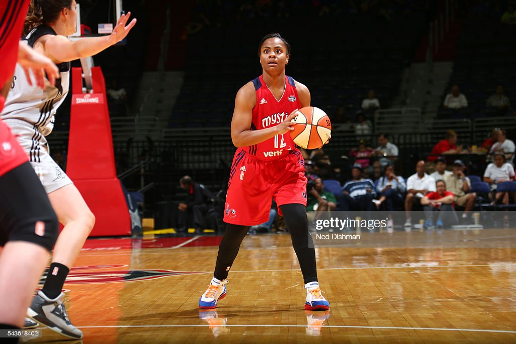 <a gi-track='captionPersonalityLinkClicked' href=/galleries/search?phrase=Ivory+Latta&family=editorial&specificpeople=707962 ng-click='$event.stopPropagation()'>Ivory Latta</a> #12 of the Washington Mystics handles the ball against the San Antonio Stars on June 29, 2016 at the Verizon Center in Washington, DC.