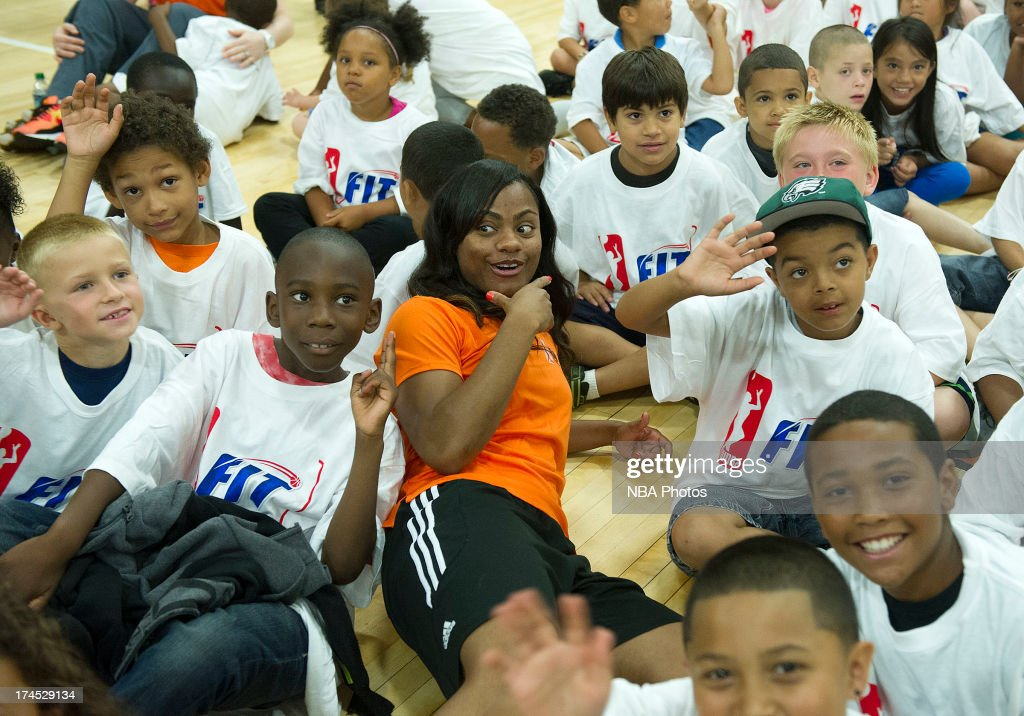 Ivory Latta of the Washington Mystics poses with children during the WNBA Cares Jamba Juice FIT Clinic on July 26, 2013 at Benjamin Dover Jackson Middle School in New London, Connecticut.