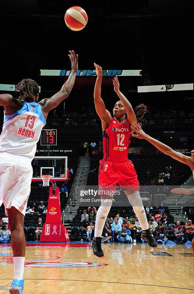 Ivory Latta #12 of the Washington Mystics puts up a shot against the Atlanta Dream at Philips Arena on August 28 2013 in Atlanta, Georgia.