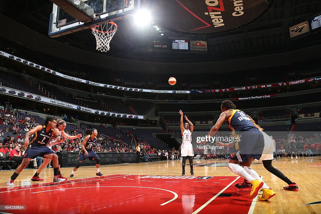 <a gi-track='captionPersonalityLinkClicked' href=/galleries/search?phrase=Ivory+Latta&family=editorial&specificpeople=707962 ng-click='$event.stopPropagation()'>Ivory Latta</a> #12 of the Washington Mystics shoots a free throw against the Indiana Fever in Game Two of the Eastern Conference Semifinals during the 2014 WNBA Playoffs on August 23, 2014 at the Verizon Center in Washington, DC.