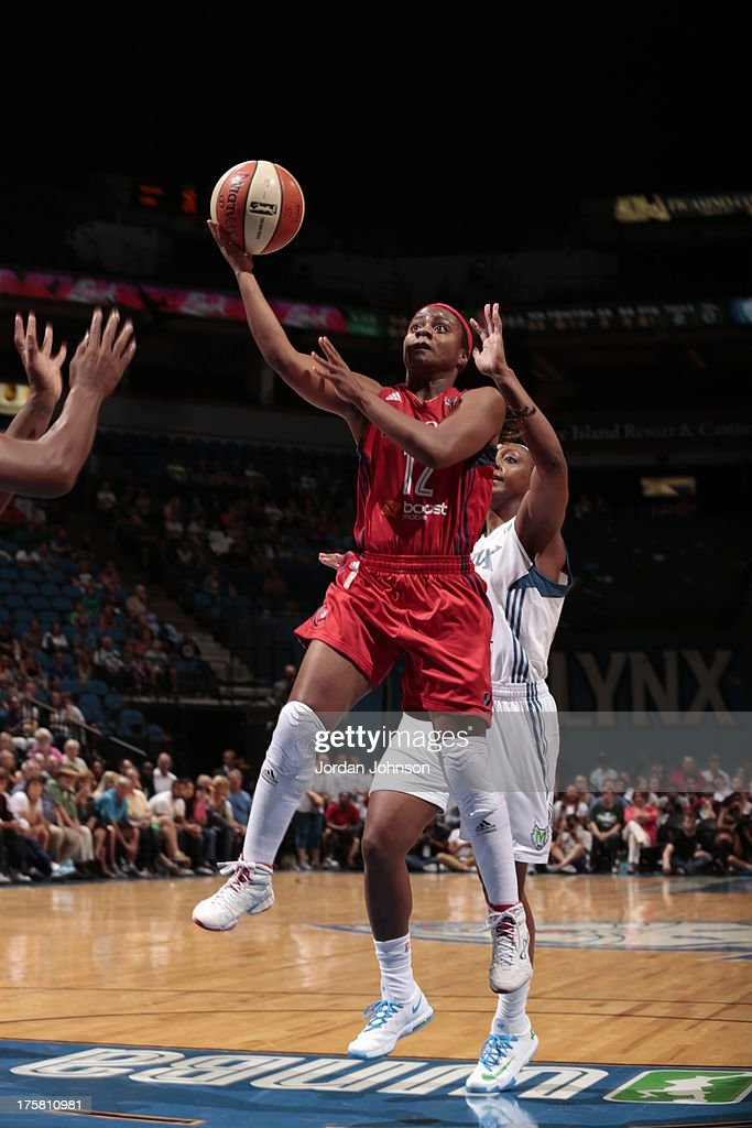 <a gi-track='captionPersonalityLinkClicked' href=/galleries/search?phrase=Ivory+Latta&family=editorial&specificpeople=707962 ng-click='$event.stopPropagation()'>Ivory Latta</a> #12 of the Washington Mystics shoots against Monica Wright #22 of the Minnesota Lynx during the WNBA game on August 8, 2013 at Target Center in Minneapolis, Minnesota.