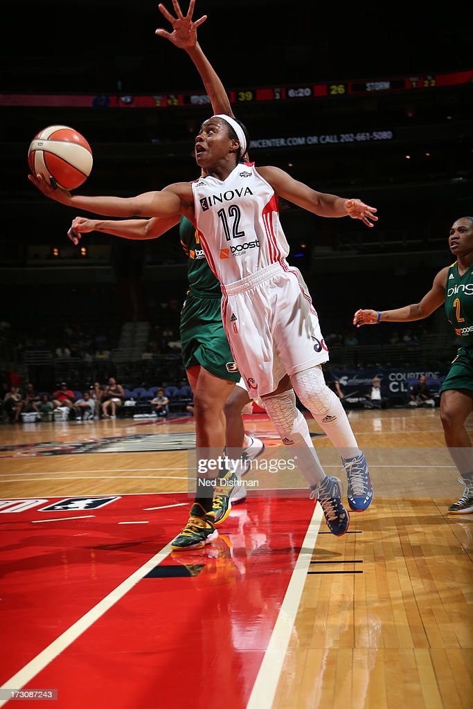 <a gi-track='captionPersonalityLinkClicked' href=/galleries/search?phrase=Ivory+Latta&family=editorial&specificpeople=707962 ng-click='$event.stopPropagation()'>Ivory Latta</a> #12 of the Washington Mystics shoots against the Seattle Storm at the Verizon Center on July 6, 2012 in Washington, DC.