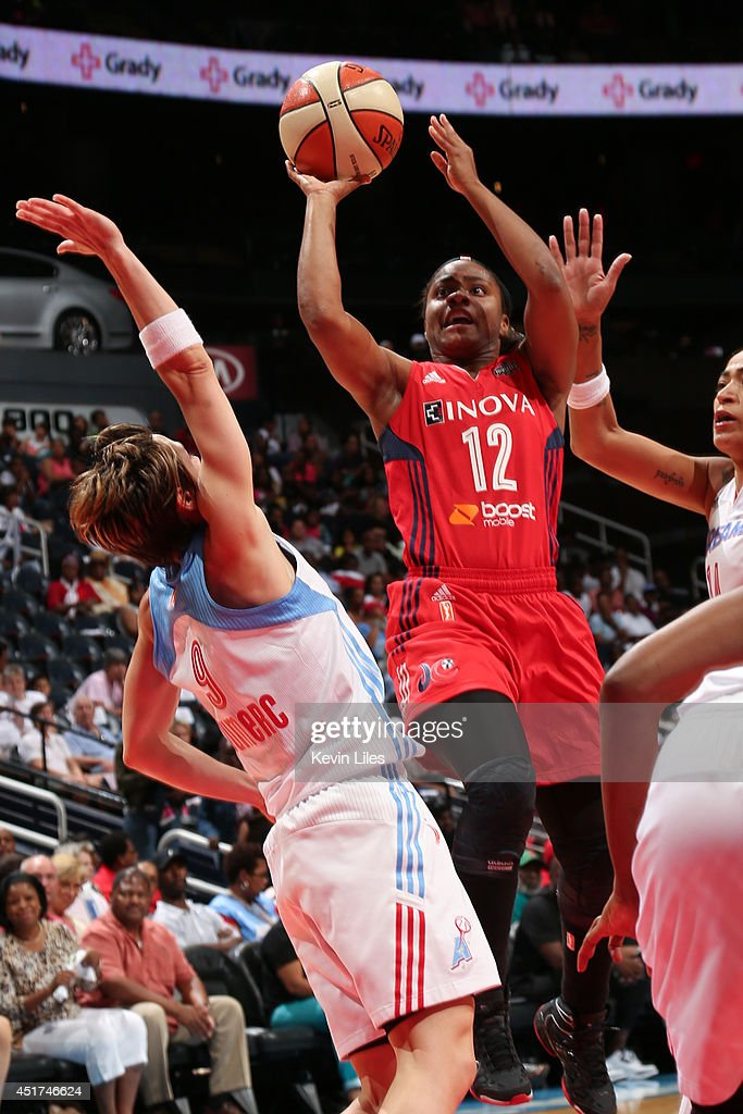 Ivory Latta #12 of the Washington Mystics takes a shot against the Atlanta Dream at Philips Arena on July 5, 2014 in Atlanta, Georgia.