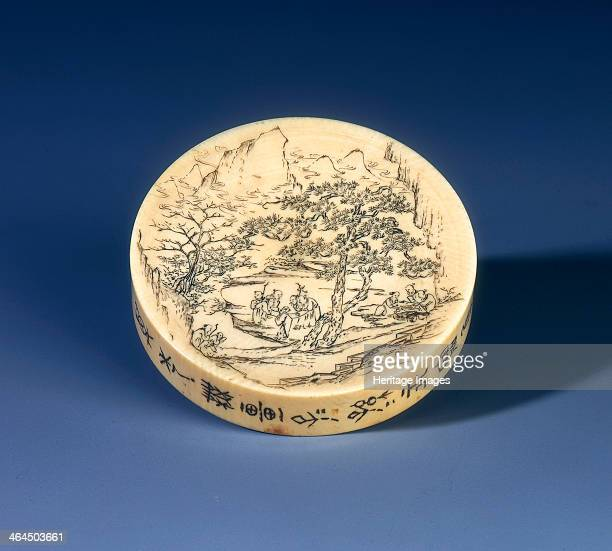 Ivory snuff tray Qing dynasty China 1898 A dated ivory circular snuff tray with stained incised decoration of immortals on a tree raft on one side...
