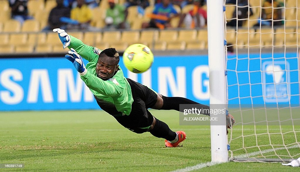 Ivory's Coast goalkeeper Daniel Yeboah eyes the ball as he tries to catch it during a 2013 African Cup of Nations Group D football match in Rustenburg, on January 30, 2013 at Royal Bafokeng Stadium.