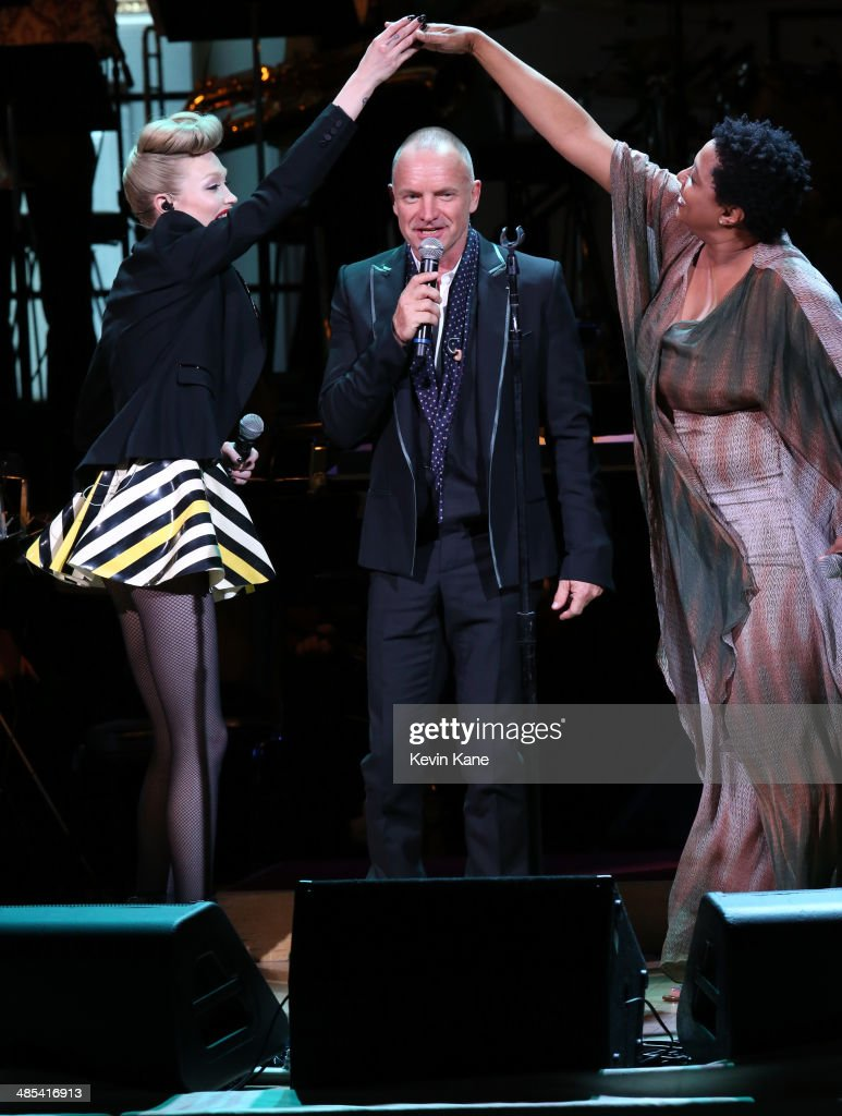 Ivy Levan, Sting and Lisa Fischer perform on stage at The 2014 Revlon Concert For The Rainforest Fund at Carnegie Hall on April 17, 2014 in New York City.