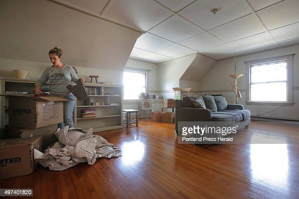 Ivy McGrew unpacks boxes in her new apartment in Portland's West End on Tuesday April 28 2015 McGrew moved to Maine from California to take a job...