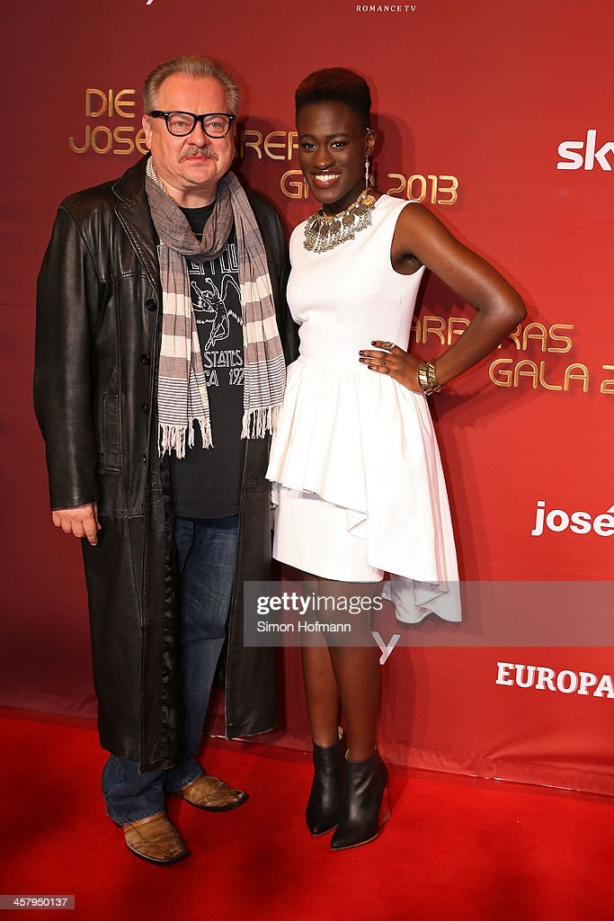 Ivy Quainoo and Heinz Rudolf Kunze attend the 19th Annual Jose Carreras Gala at Europapark on December 19, 2013 in Rust, Germany.